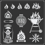 BBQ and grill labels set. Barbecue emblems, badges and design elements. Vector monochrome illustration Stock Images