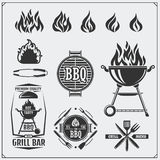 BBQ and grill labels set. Barbecue emblems, badges and design elements. Vector monochrome illustration. Stock Photos