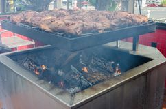 BBQ Grill loaded. Loaded bbq grill with racks of beef and pork royalty free stock image
