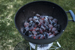 BBQ Grill Pit Glowing And Flaming Hot Charcoal Briquettes coal Food Background Or Texture Close-Up Top View Royalty Free Stock Image