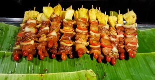BBQ Grill. Pork And Vegetables Skewers Cooking On BBQ Grill royalty free stock images