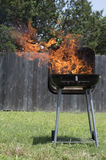 BBQ Grill. A small grill with a huge fire Royalty Free Stock Image