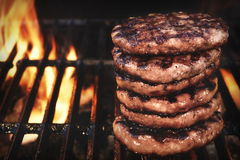BBQ Grilled Burgers Patties On The Hot Flaming Grill Stock Photos