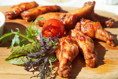Bbq grilled chicken wings on wooden plate Stock Image