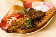 Bbq , grilled cutlet and bacon with salad Royalty Free Stock Images