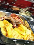 BBQ grilled meat and slices of yellow corn polenta 8 Stock Images