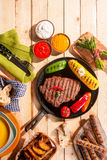 BBQ Grilled Meats and Vegetables on Picnic Table Stock Images