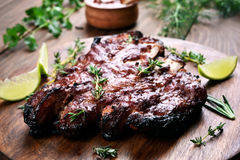 Bbq, grilled pork ribs. On wooden board, shallow depth of field Stock Photo