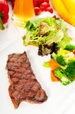 BBQ grilled rib eye ,ribeye steak and vegetables Royalty Free Stock Photography