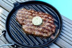 Bbq a grilled steak at  the swimming pool Stock Images