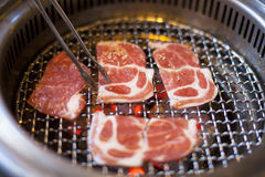BBQ, grilling meat or beef on flame Stock Photo