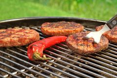 BBQ Hamburger Patties And Chili Pepper On The Hot Grill Royalty Free Stock Photography