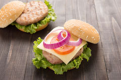 Bbq hamburger on the wooden background Stock Image