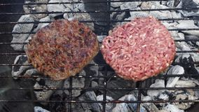 BBQ with hamburgers stock video footage