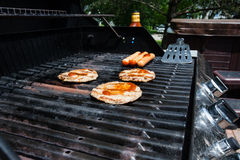BBQ with Hamburgers & Hotdogs Stock Photography