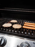 BBQ with Hamburgers & Hotdogs Stock Images