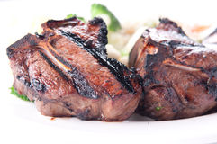 Bbq lamb chops, grilled to perfection with vegetable risotto Stock Photography