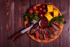 BBQ lamb steak with vegetable and herb on dark wooden background Royalty Free Stock Image