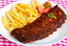 BBQ , marinated spareribs and french fries Royalty Free Stock Images