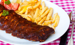 BBQ , marinated spareribs and french fries Stock Photography