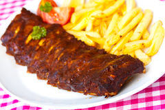BBQ marinated spareribs and fries Stock Photos