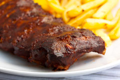 BBQ marinated spareribs and fries Royalty Free Stock Photo