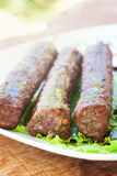 BBQ Meat kebab. Barbecue meat kebab served on a lettuce Stock Photos
