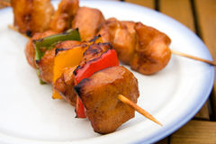 BBQ meat with paprika. On white plate stock photography