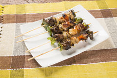 Bbq meat on sticks, kebab skewers with vegetable sticks.  royalty free stock photos