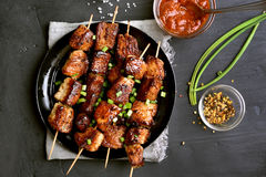 Bbq meat on wooden skewers Royalty Free Stock Images