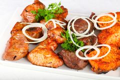 BBQ mix. Chicken, pork, beef and salmon stock image