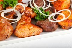 BBQ mix. Chicken, pork, beef and salmon stock photos