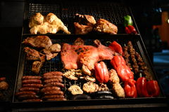 BBQ in Montevideo in Uruguay. Meat and peppers on a grill in Montevideo Stock Photo