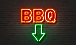 BBQ neon sign on brick wall background. royalty free stock photography