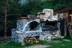 BBQ oven made of stone. In the courtyard of the house Stock Images