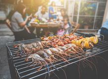 BBQ Party happy summer family dinner at home outdoor vintage sty. Le parent and child charcoal stove Stock Photography