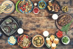 BBQ, picnic, beer, Memorial Day, united states, lunch, a day off. Barbecue picnic in honor of Memorial Day in the United States or lunch weekend in the open air Stock Image
