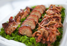 BBQ. Pork on a bed of parsley stock photo