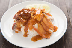 BBQ Pork and Crispy Pork over Rice with Sweet Gravy Sauce. Royalty Free Stock Photography