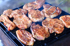 BBQ. Pork meat on a charcoal grill Royalty Free Stock Photos