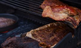BBQ pork meat and sausages on the grill. Stock Image