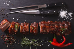 BBQ pork ribs chopped close-up on a table. Horizontal top view Stock Images