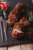 BBQ pork ribs close-up on a table with the ingredients. vertical Stock Photo