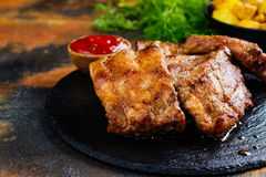 BBQ pork ribs. And golden potato wedges. Copy space stock photo