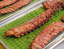 BBQ Pork Ribs on grille in market Royalty Free Stock Photos