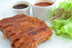 BBQ Pork Ribs. BBQ ribs with sauce and salad Royalty Free Stock Image