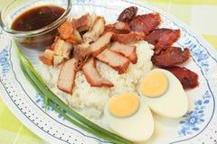 BBQ Pork, sausage, crispy pork over rice. Royalty Free Stock Images