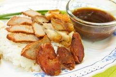 BBQ Pork, sausage, crispy pork over rice. Stock Image