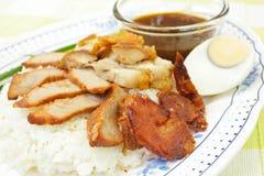BBQ Pork, sausage, crispy pork over rice. Stock Photography