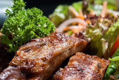 BBQ Pork Spare Ribs with french fries and salad Stock Images